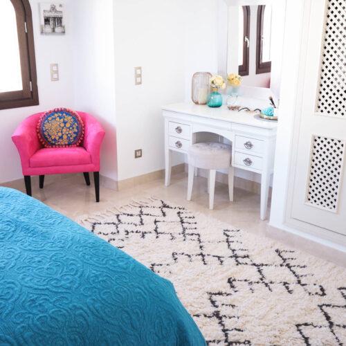 spanish bedroom, interiors, white interiors, pink chair